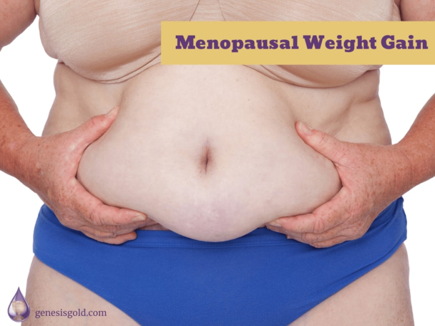 woman squeezing her belly fat